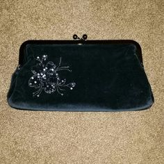 "Express black velvet clutch/large wallet NWOT Black velvet large wallet that can also be worn as a clutch! Cute sequin flower detail on front. Change purse closure. Perfect for the upcoming holiday season!  9"" L x 2"" W x 5.5"" H Express Bags Clutches & Wristlets"