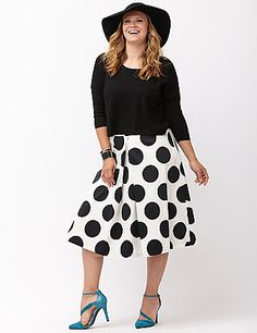 Who can resist playful polka dots? This box pleat midi skirt flounces into your favorites with its flattering flare and feminine movement. Tuck in a bright tee and you're right on-trend! Hidden back zipper closure. lanebryant.com