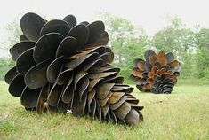 Old Shovel garden sculptures...... that is a lot of shovel heads!