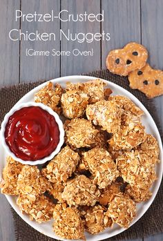 1 cup flour  1/2 tsp. salt  1/2 tsp. freshly-ground black pepper  2 eggs, whisked (or you can substitute 3 egg whites)  2 cups finely-crushed pretzels (I used Pretzel Crisps)  3 boneless, skinless chicken breasts, cut into bite-sized (about 1-inch) pieces