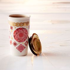 A double-walled ceramic mug ornamented with a jewelry design. Part of our Dot Collection.