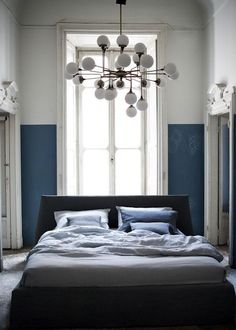 distract free bedroom- cool/calming blue and white. Bedhead against opposite wall facing window. Floor length curtains. Plant on small table at window. Other air purifying plants around. 2 corner shelves above either side of bed with trailing plants. shelf above bed for candles, goddess fertility rose quartz statue, etc.