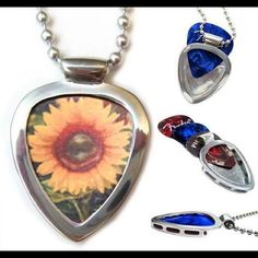 "Pickbay Guitar Pick Holder + Sunflower guitar pick Pickbay is the BEST gift set! Hypoallergenic Stainless steel PICKBAY guitar pick holder pendant necklace set comes with a Sunflower guitar pick plus 3+ cool guitar picks, a 24"" hypoallergenic stainless steel bigger ball chain all packaged together in a velvet polishing pouch, ready for gift giving! The gift they will wear forever! Ships from Los Angeles. Pickbay.com Jewelry Necklaces"