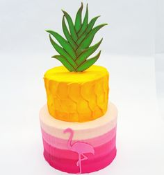 This tropical themed cake will warm you right up! Pineapples and flamingos!