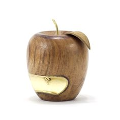 The only apple a doctor won't recommend. This little bottle opener will make sure your sugary thirst gets quenched. Made with reclaimed wood and outfitted with a brass stem and suede leaf.