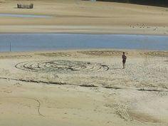 FACEBOOK 16 Aug Chris Reinders. Calligraphy on beach Site_Specific #LandArtBiennale. #LandArt. #Plett