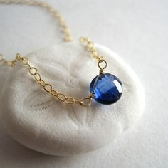 The tiniest faceted cobalt-blue kyanite circle is centered on gold-filled chain that fastens with a simple spring clasp closure.    Length: 18,