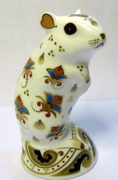 A Royal Crown Derby paperweight, Gerbil, with silver stopper and box, height 11cms