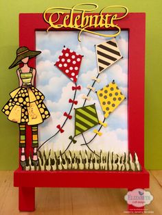 This decorative piece by Jackeline Hernandez has us dreaming about spring! Delicately combining Joset Designs Kites, Susan's Garden Club CountryScapes Clouds & Grass, A Way With Words Celebrate and a black Jacky's Dolls 1 peel-off sticker this project beautifully comes together. Finish off this piece with some Warm Diamond Silk Microfine Glitter and Through The Lens Wood series patterned cardstock. Read more here: http://blog.elizabethcraftdesigns.com/2016/01/celebrate/