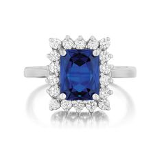 Rings Under $1,500. Style LEF071.11, emerald-shaped sapphire engagement ring with diamond halo set in 14kt white gold, Leo Ingwer