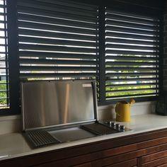 Metal louvre in outdoor kitchen