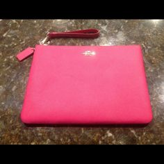 "Coach iPad Clutch NWT Beautiful Ruby Pink Coach iPad Clutch!  Zip closure with a card slot on the back. Detachable matching leather wristlet strap. Interior is fabric lined and has a large multi function slip pocket on one side and 2 multi function pockets on the opposite side along with a pen/pencil pocket.  approximately 11.75"" x 8.5""   NWT  No Trades Coach Accessories"