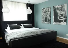 The Chic Allure Of Black Bedroom Furniture (Then there are those colors that have a soothing effect when combined with black. For example, the chill gray-blue shade of this next modern bedroom is perfectly complemented by the black bed and draperies, as well as the gray-toned artwork) with a black chandelier