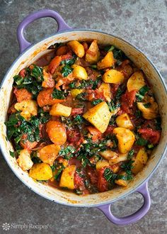 A ragout of roasted root vegetables—parsnips, carrots, beets, rutabagas—with tomatoes and kale