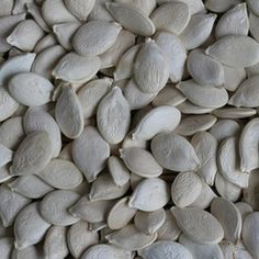 Raw pumpkin seeds provide a rich source of fiber, a type of carbohydrate that prevents constipation and benefits digestive health. The seeds also boost your intake of protein -- each ounce of seeds provides almost 9 grams of the nutrient.