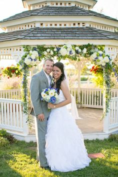 Beautiful real Kansas City wedding at Lone Summit Ranch. We decorated the gazebo for the outdoor ceremony with ivory, blue, and green including fluffy hydrangeas, roses, and blue delphinium. photo by @janamariephotos