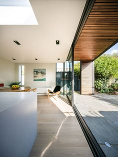 Architect Henry Goss has completed a rusted steel and timber-clad extension to a house near Cambridge, England.