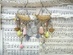 religious earrings chandelier medals assemblage by lilyofthevally