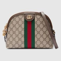 8e0afdca52 Shop the Ophidia GG shoulder bag by Gucci. Crafted in GG Supreme canvas  with inlaid Web stripe detail