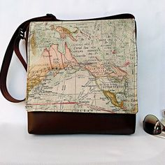 Large Expedition world map feature flap and black messenger vegan faux leather vinyl cross body crossbody shoulder bag handbag