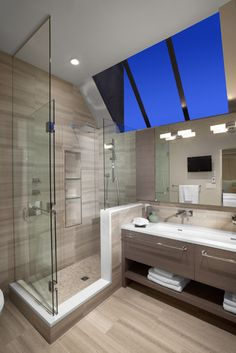 I'd love to have a skylight in my bathroom.  I also love the clean lines and the shelf underneath the sink!  #mykindastyle