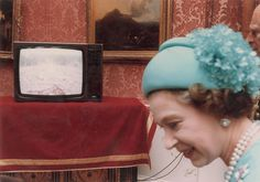 Here's the Queen behind the scenes of the Royal Wedding in 1981. Click through for more candid shots.