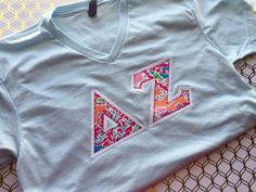 Lilly pulitzer Greek vneck Shirt, ADPi v neck, Zeta vneck, Alpha Gam v neck, Kappa Delta v neck, Delta Zeta v neck, delta gamma v neck by LittleGreekBoutique on Etsy https://www.etsy.com/listing/468837235/lilly-pulitzer-greek-vneck-shirt-adpi-v