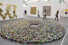Kader Attia's 'Halam Tawaaf' installation, made of beer cans from the Lehmann Maupin gallery, at Frieze New York. Nearly 200 galleries are represented at this year's fair.