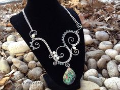 Wire wrapped swirl necklace with abalone pendant
