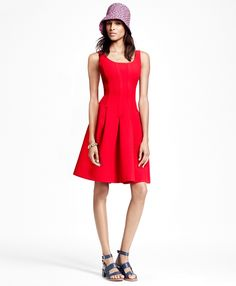 """This sleeveless fit-and-flare dress is made from a semi-heavy textured Italian Campore wool crepe. The perfect contour is attributed to exquisite dressmaker seaming that is visually flowed into inverted pleats to provide the skirt with just the right amount of movement. <br/><br/> Scoop neck; hidden back zip closure; 36½""""; dry-clean; imported."""