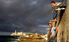 A fisherman enyoys a cigarrete after fishing along with another collegues at the Malecon in Havana. (AP Photo/Javier Galeano)