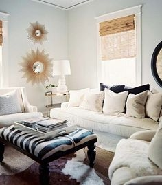 I like how the couches are plain and the ottoman is colorful and has a fun pattern. it makes the room pop