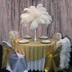 Maybe feather centerpieces would be pretty.why yes, yes they would!