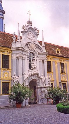 Baroque doorway and facade of the Stiftskirche in Duernstein, Austria. ~ this entrance to the church is in a large, very charming courtyard. The church interior is beautiful and has an intimate rather than grand feeling.