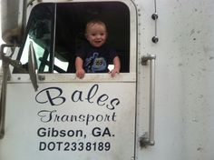 John playing in his daddys truck.