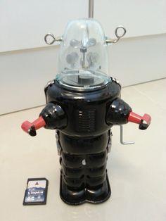 Tin Toy Robot Turn Around UFO Space Ship Spacman Sci-Fi Wind Up. $39.99, via Etsy.