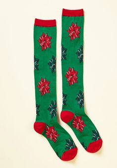 <p>Let your 'presents' be known in these knee-high socks! Promoting your favorite part of the holidays - flattering your friends and family with fun packaging - this red and green pair does all the work of flaunting your festiveness.</p>