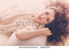 Portrait of a sexy girl lying on the pillows in the bedroom. Photos of high angle. Boudoir fashion. @shutterstock