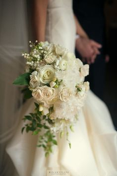 cascade bouquet, lily of valley, peony, freesia, smilax