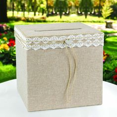 This natural burlap card box wrapped with lace and jute cording has a silver-tone heart charm that will add a sense of flair to any party. Feel like a kid on Valentine's Day with this beautiful letter box.