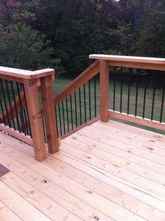 Cedar decking with hammered bronze spindles