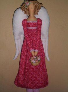 Corpo e roupa em tricoline 100% algodão <br>Cabelo - rami natural cacheado artesanalmente <br>Cestinha de cipó com flores secas