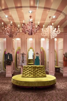 Retail Design | Store Interiors | Shop Design | Visual Merchandising | Retail Store Interior Design | Changing Rooms | Love the ceiling detail, chandeliers and yellow dressing room mirrors!