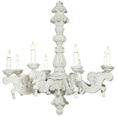 Vintage French Carved and Painted Chandelier   From a unique collection of antique and modern chandeliers and pendants  at http://www.1stdibs.com/furniture/lighting/chandeliers-pendant-lights/