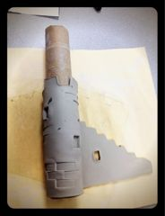 clay castles from a slab.  Rolling on a paper towel tube helps keep the shape while clay dries.