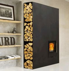 Interesting firewood storage and wood Fireplace Stove by Wittus Home Fireplace, Fireplace Design, Modern Fireplace, Metal Fireplace, Black Fireplace, Fireplace Ideas, Contemporary Fireplaces, Corner Fireplaces, Decorative Fireplace