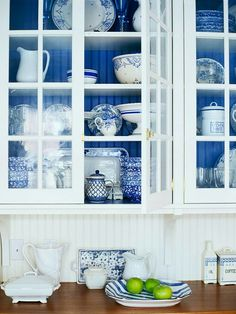 Kitchen cabinets- white with glass and a colored backdrop