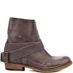 Searching for the perfect ankle boot doesn't have to be hard when this Bronx style is available.  Easy Rider brings you a soft grey leather with a slight distressed look.  A wrap around buckle adds to this versatile style and a sturdy 1 inch block heel finishes off the look.