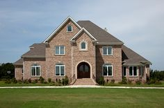 Brick inspires the imagination. This beautiful home has it all, from a dramatic brick staircase to classy arches and headers finished with keystones. Learn more about what you can do with brick at http://insistonbrick.com/.
