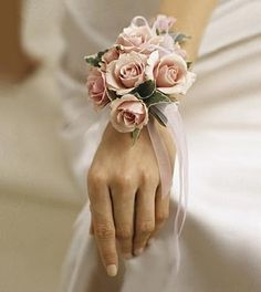 "Pure Grace™ Wrist Corsage by Peachtree Petals in Atlanta! Pink spray roses, ivy, and soft pink ribbon make up this very feminine wrist corsage. Approx. 7""h x 4""w"